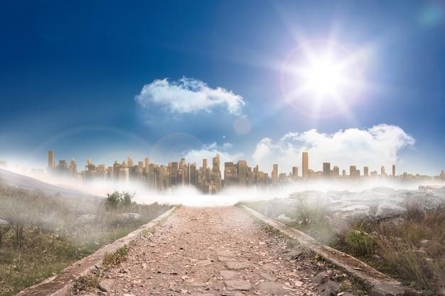 Stony path leading to large urban sprawl under the sun