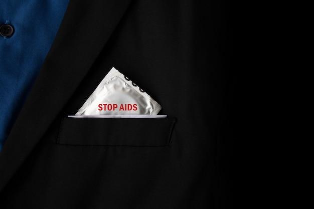 Stop aids and hiv concept. closeup condoms in a black suit