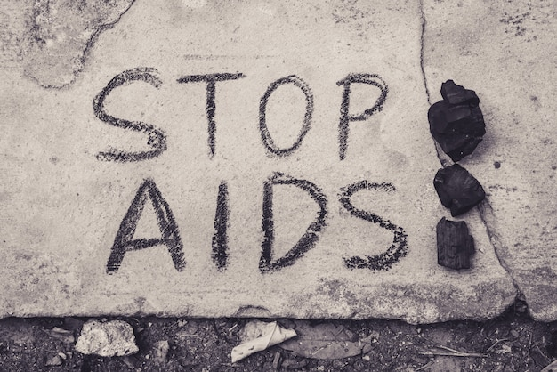Stop aids text hand write by black chacoal.