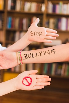 Stop bullying message on children's arms