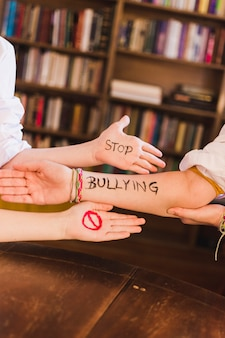 Stop bullying slogan on children's arms