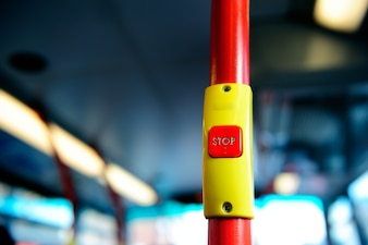 Stop button on the London red bus