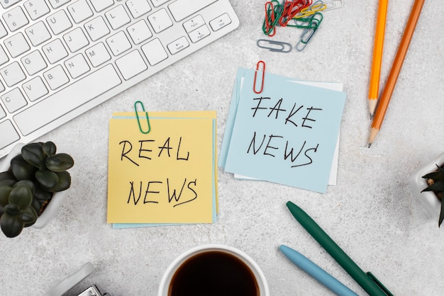 Stop fake news concept with post-its above view