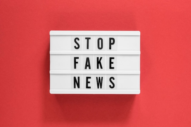 Stop fake news red background