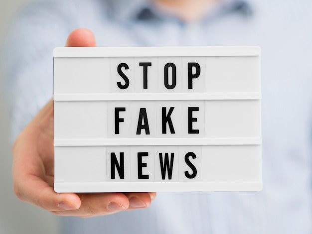 Stop fake news on white board