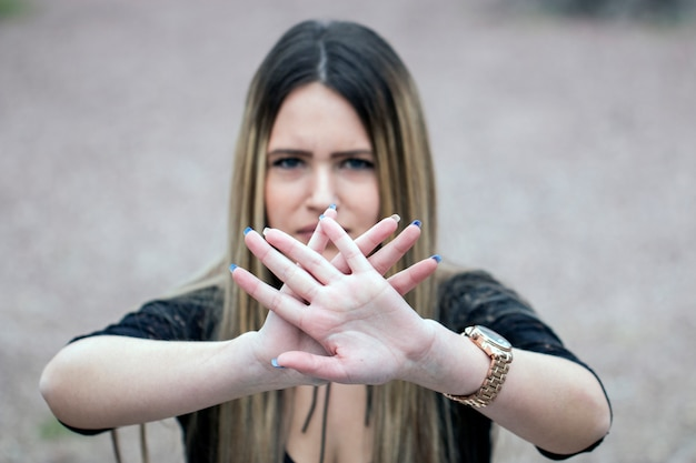 Stop hand of woman sign of discrimination