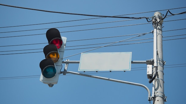 Stop light and traffic light at intersection in city of japan.