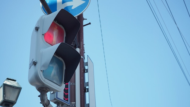 Stop light and traffic light at intersection  for people to walk in city of japan.