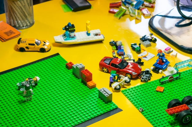 Stop motion animation process with lego details and toy cars