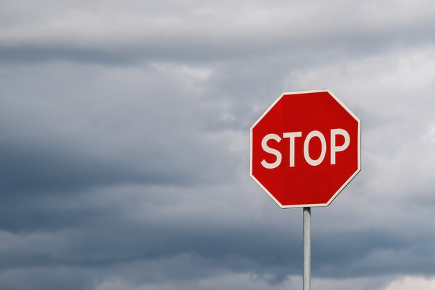 Stop sign against dramatic cloudy sky. abstract background and texture for design.