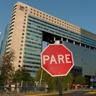 Stop sign in front of a building, santiago, santiago metropolitan region, chile