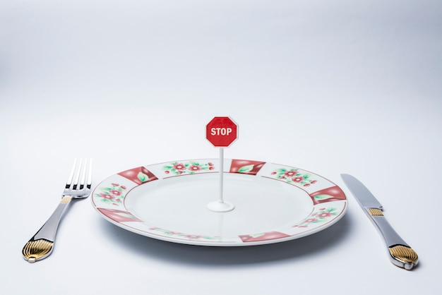 Stop sign on a white plate.