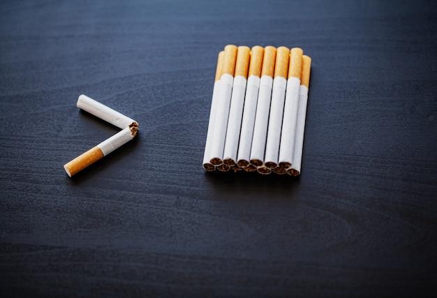 Stop smoking concept with broken cigarettes. heap of cigarettes. no smoking