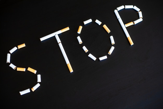 Stop smoking concept with broken cigarettes. heap of cigarettes. no smoking