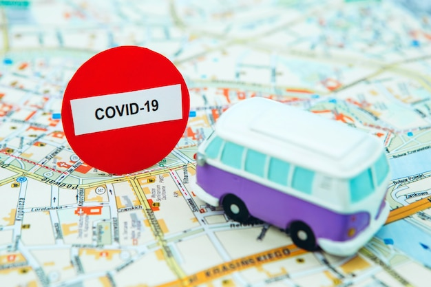 Stop traveling due to coronavirus. the covid-19 epidemic has stopped tourism worldwide. closing of airports and bus stations. passports on the map and stop sign.