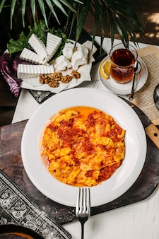 Stop view of traditional azerbaijani breakfast with egg and tomato dish