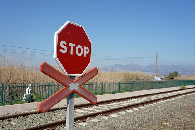 Stop warning sign on the rails in the station