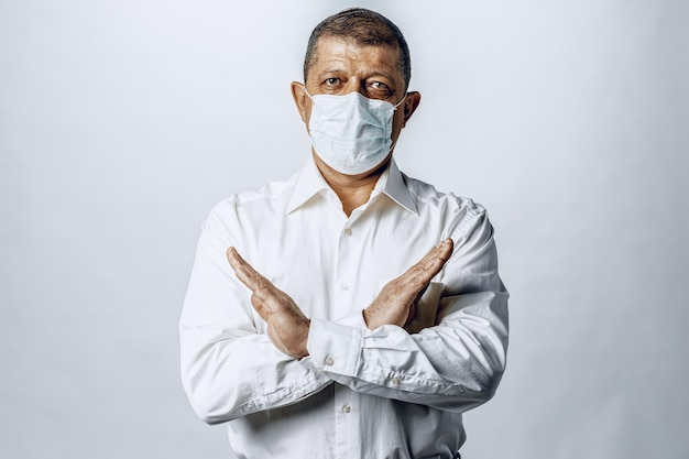 Stop world pandemia of coronavirus. portrait of a man in shirt wearing protective mask