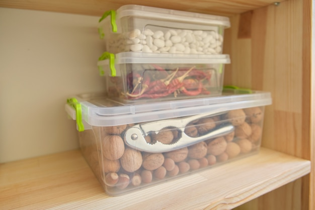 Storage cabinet in kitchen with wooden shelves with food