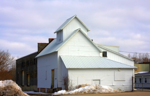 Storage house with a cloudy blue sky in the background