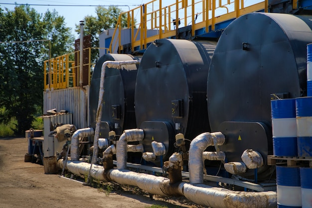 Storage tanks in blue sky background.