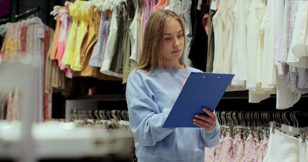 Store manager checking stock in a clothing store. small business owner orders merchandise.