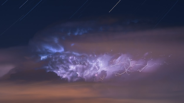 Storm cloud evolution full of lightning over the night sky
