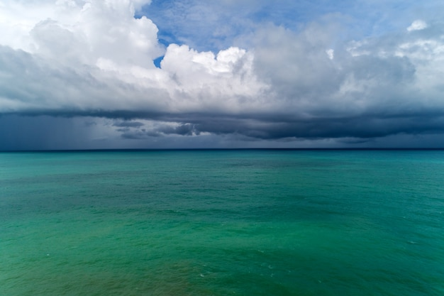 Storm clouds over sea aerial view drone photography.