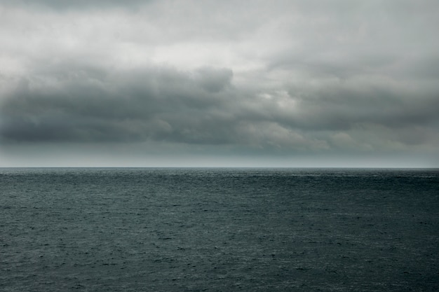 Stormy clouds or rain clouds over a dark sea