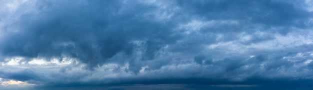 Stormy sky panorama with blue clouds before the rain. weather forecast concept.