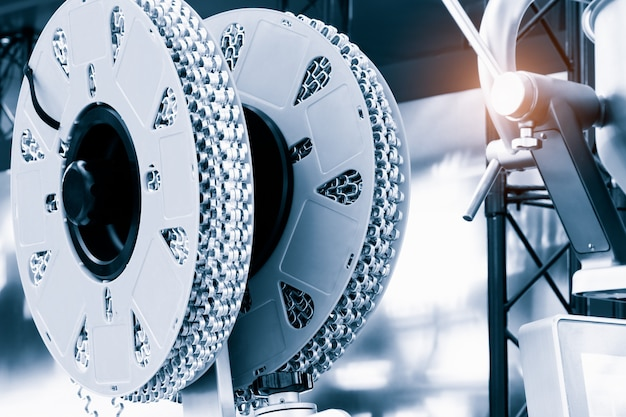 Strand roller chain going around  sprockets on industrial machine. industrial engineering  technology concept background