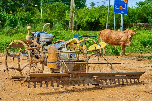 A strange homemade tool for plowing a field from a rebuilt motorbike