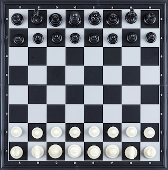 Strategy and chess concept with chess figures on checkerboard  top view.