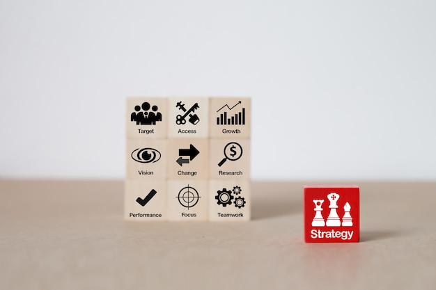 Strategy icons on wooden block for business  growth .