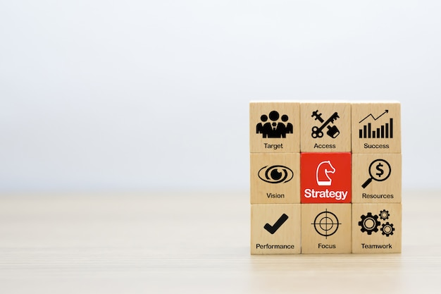 Strategy and planning graphic icons for business success on wooden blocks