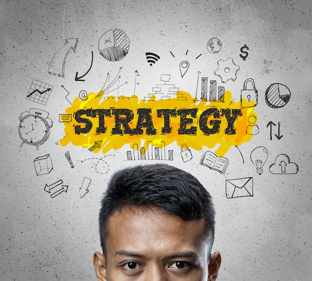 Strategy text. head of asian businessman thinking business sketch concept background.