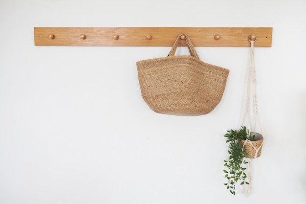 Straw bag on a hanger in the scandinavian style hall