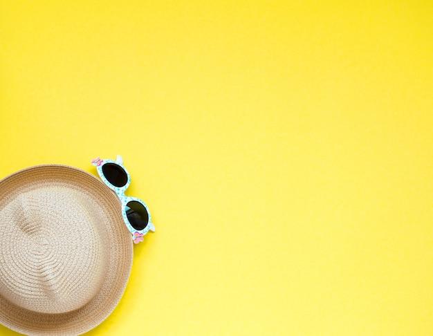 Straw beach children's 's hat and sun gasses.