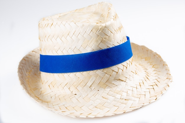 Straw hat isolated blue ribbon band on a white background