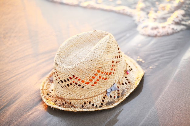 Straw hat laying on the seaside
