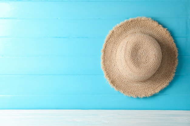 Straw hat on white table against color background, space for text. summer vacation concept