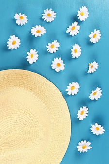 Straw hat with camomile