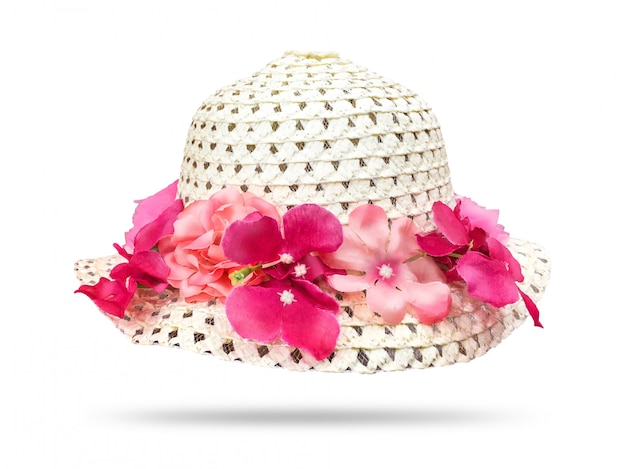 Straw hat with pink flower isolated on white background