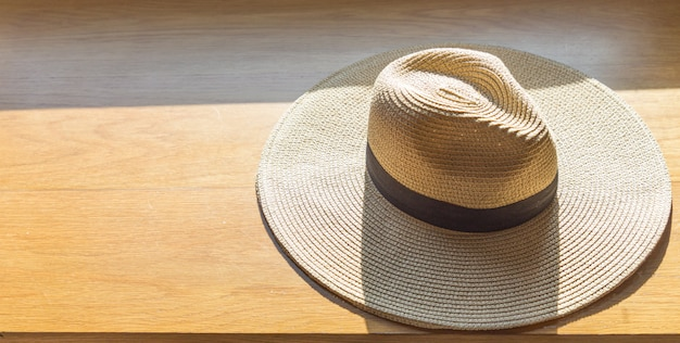 Straw hat on wood flooring