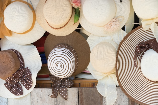Straw hats for sale, hanging on a wall