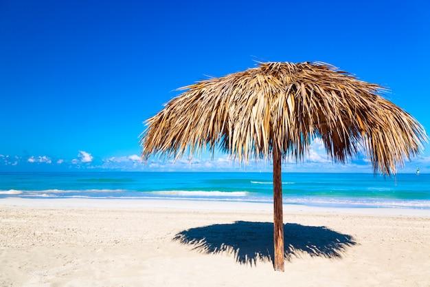 Straw umbrella on a beach. varadero, cuba