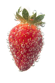 Strawberrie in water bubble over white background