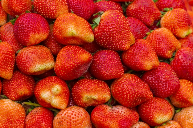 Strawberries background intense red color