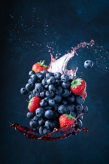 Strawberries and blueberries together flying. splash.