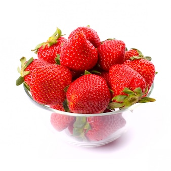 Strawberries in the bowl closeup on white background